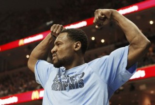 Grizzlies' Tony Allen celebrates on the bench during the third quarter in Game 3 of their NBA Western Conference final playoff basketball series against the San Antonio Spurs in Memphis